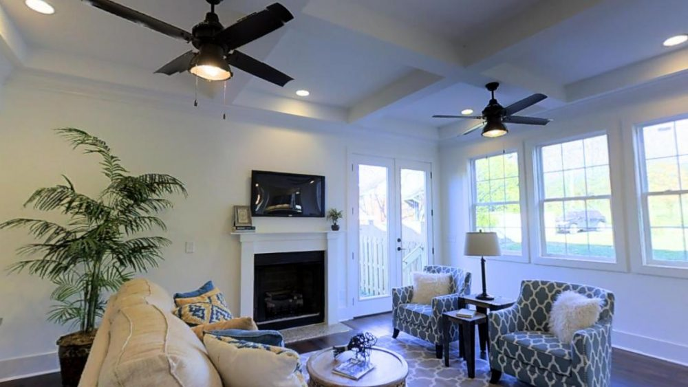 Modern White and Gray Living Room with Two Fans at 3520A Hillsdale Ave, Nashville, TN